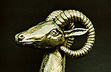 AA4. Chalcidian style Greek helmet with crest holder in the form of a goat's head. Brass. 5th-4th century B.C.