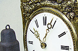 R5. Brass, bronze and iron Clock. Technique: polished and lacquered.