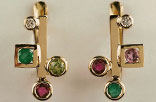 J8. Yellow gold earrings with diamonds, emeralds, rubies, a peridot and a spinel.