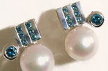 J7. Earrings in white gold, cultured pearls and blue diamonds.