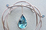 J2. White gold pendant and blue topazes.