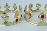 D32. Crowns. Brass and synthetic stones.